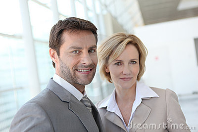 Portrait of two business people indoors