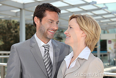 Portrait of two business people outdoors