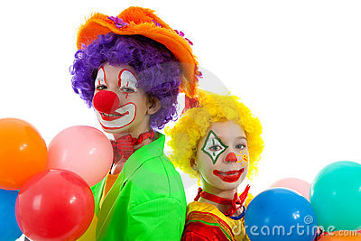 Portrait of two children dressed as clowns