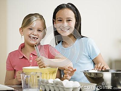 Portrait of two girls baking