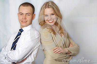 Portrait of two happy young business people