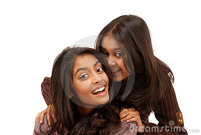 Portrait of two indian girls over white background
