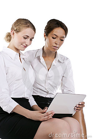 Portrait of two young businesswomen in the studio