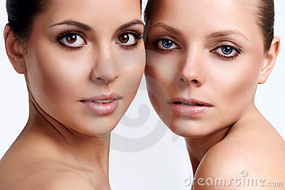 Portrait of two young girls with perfect skin