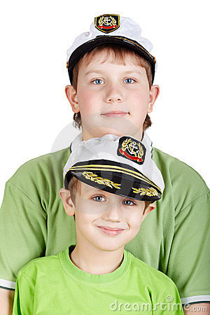 Portrait up of two boys in sea peak-cap