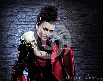 Portrait of a vampire lady holding a human skull