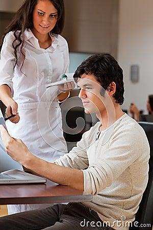 Portrait of a waitress advising a customer