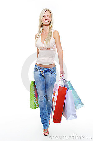 portrait of  walking woman with shopping bags