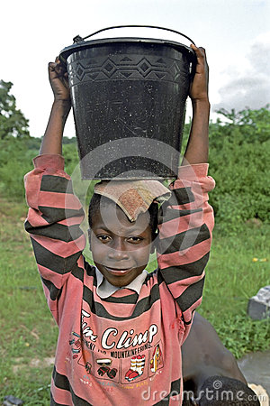 Portrait of water carrying Ghanaian boy, Ghana Editorial Photography