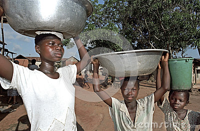Portrait of water carrying Ghanaians Girls, Ghana Editorial Photo