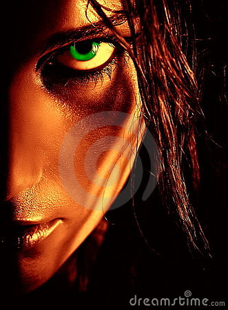 Portrait of wild green-eyed girl