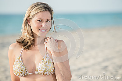 Portrait of woman in the beach with room for copy.