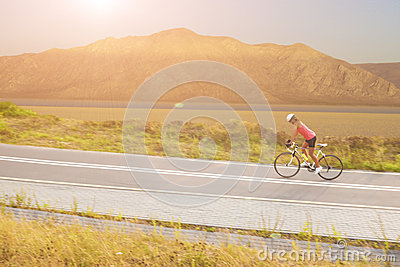Portrait of a woman on bike near the mountains