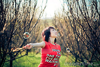 Portrait of woman with bubbles