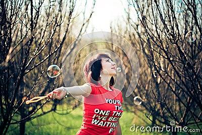 Portrait of woman with bubbles