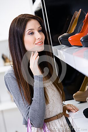 Portrait of woman choosing a pair of footwear