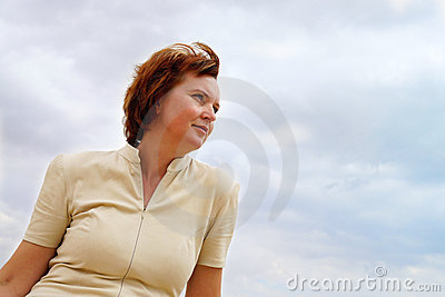 Portrait of a woman in the clouds