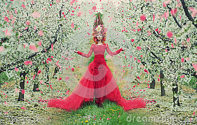 Portrait of the woman in the colorful orchard