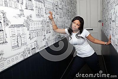 Portrait of a woman in corridor