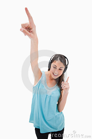 Portrait of a woman dancing while listening to music