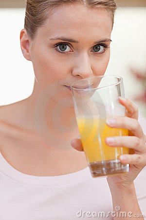 Portrait of a woman drinking juice