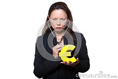 Portrait woman examining Euro stethoscope