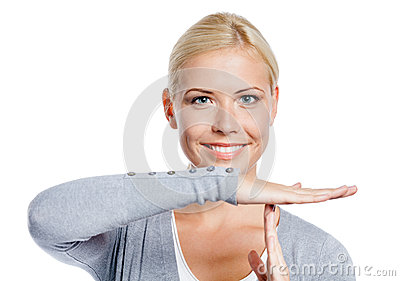 Portrait of woman gesturing time out