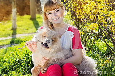 Portrait of a woman with her dog outdoors Stock Photo