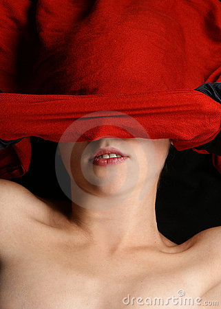 Portrait of a woman hiding behind a silk blanket
