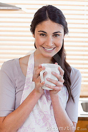 Portrait of a woman holding a cup of tea