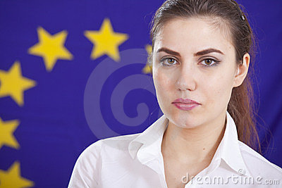 Portrait of woman over european flag