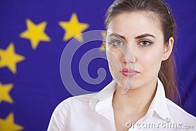 Portrait of woman over european flag