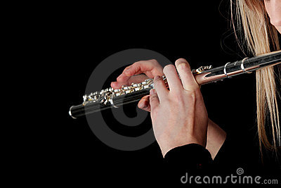 Portrait of a woman playing transverse flute