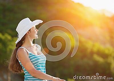 Portrait of woman on vacation enjoying sunset