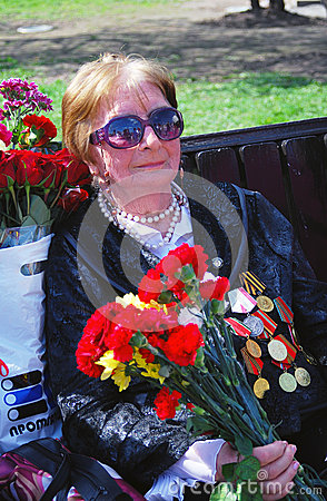 Portrait of a woman veteran with flowers Editorial Photo