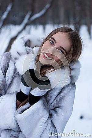 Portrait of woman in winter landscape