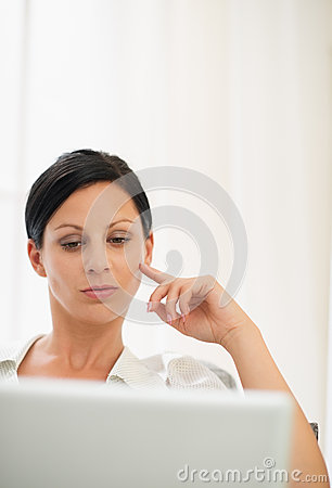 Portrait of woman working on laptop