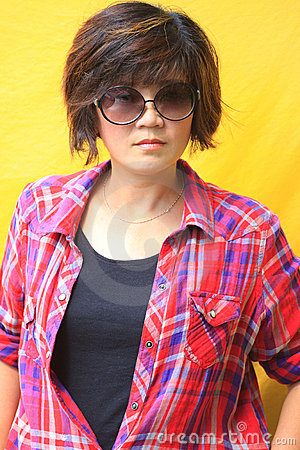 Portrait of women in plaid shirt.