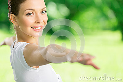 Portrait of working out girl with outstretched arms