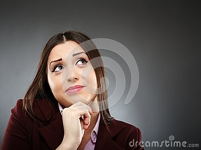 Portrait of a worried businesswoman with hand on chin