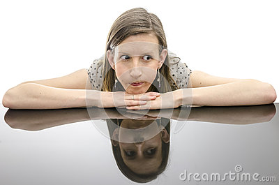 Worried woman leaning on a table