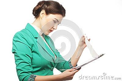 Portrait of writing businesswoman