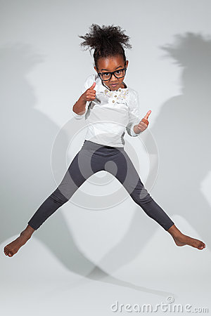 Portrait of Young African American girl jumping