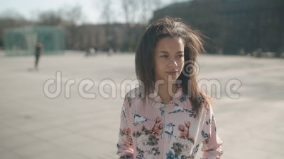 Portrait of young African American woman posing to a camera, outdoors. Portrait of a young beautiful woman in urban background stock footage