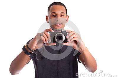 Portrait of a young african man taking a picture