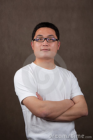 Portrait of a young asian man in a white t-shirt