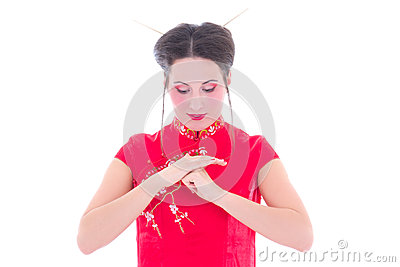Portrait of young attractive brunette in red japanese dress isol