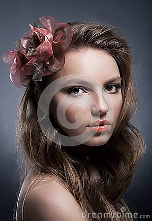 Portrait of young attractive girl with bow closeup