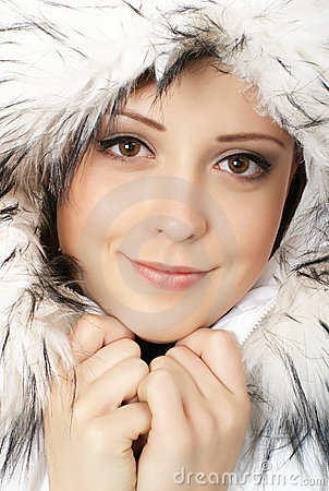 Portrait of young attractive winter woman