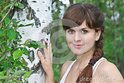 Portrait of a young beautiful girl in birch